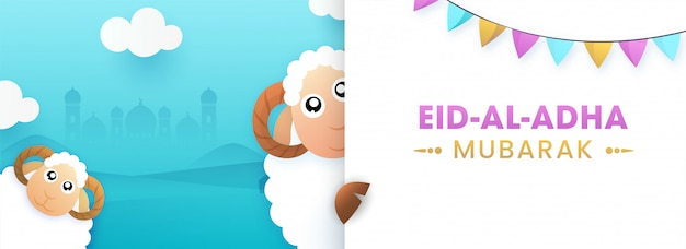 Eid-al-adha mubarak text with two cartoon funny sheep and bunting flags on white paper and sky blue silhouette mosque background.
