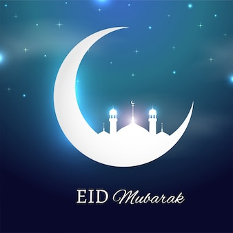 Eid mubarak concept with shiny crescent moon and mosque