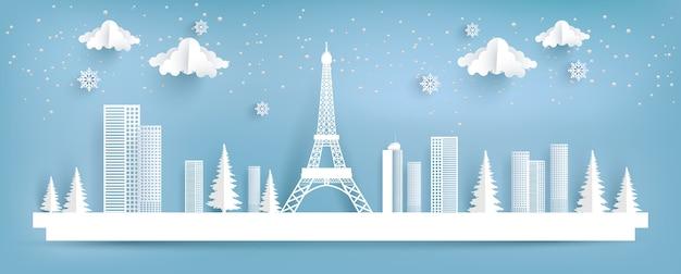Эйфелева башня и город зимой. дизайн бумажного искусства.