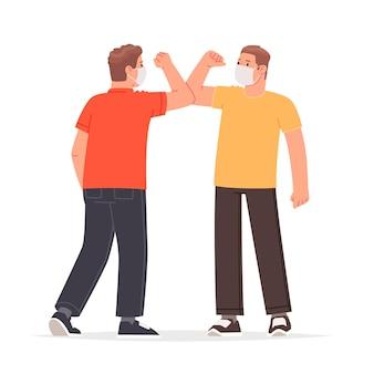 코로나바이러스 전염병 동안 팔꿈치 인사 마스크를 하는 사람들은 만날 때 제스처를 인사합니다.