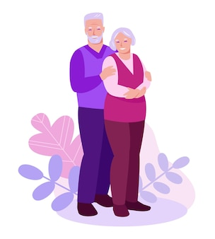 Elderly couple on a background of leaves, plants.