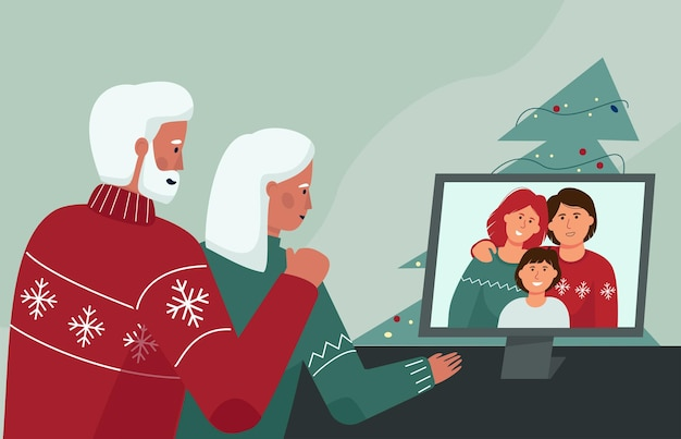 An elderly couple communicates with relatives through a video conference christmas online