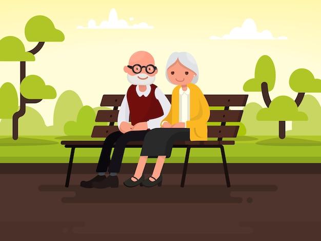 Пожилая пара на открытом воздухе. бабушка и дедушка сидят на скамейке в парке.