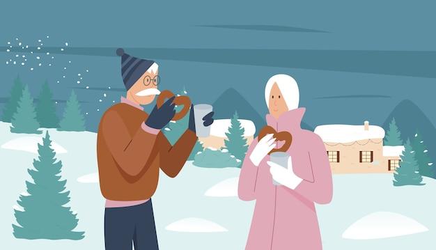 年配のカップルの人々はクリスマスの冬の休暇シーズンを楽しんでいます