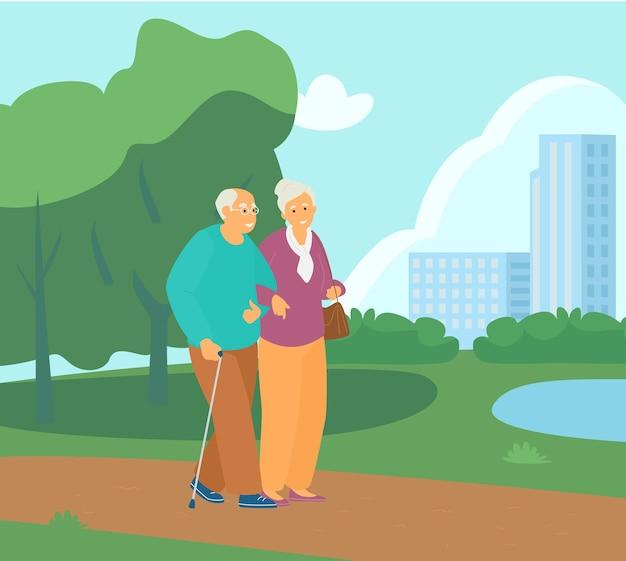 公園で腕を組んで歩く老夫婦。アクティブリタイアメント。健康的な生活様式。