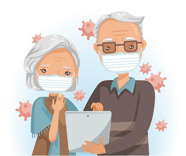 高齢者のマスクをタブレットで読むか、タブレットを使用します。老夫婦がコロナcovid-19ウイルスを探す。医療コンセプト。コロナウイルス関連