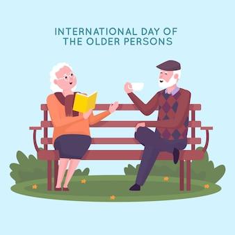 屋外でベンチに座って話している高齢者