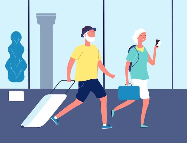 Пожилые путешественники. пара в аэропорту с чемоданами. туристы на вокзале или международном терминале