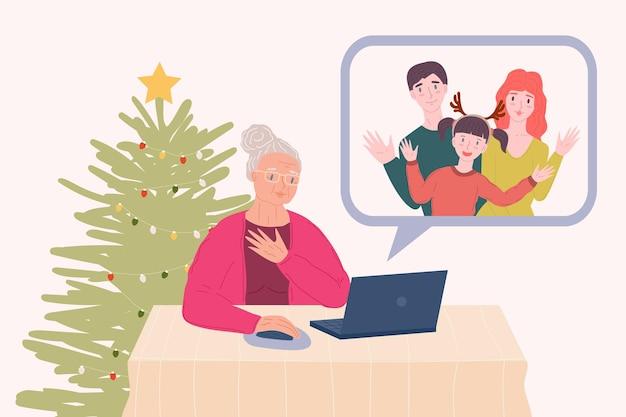 노트북과 인터넷을 통한 원격 가족 온라인 통신을 가진 할머니