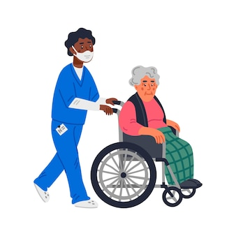An elderly woman in a wheelchair and male nurse in a face mask
