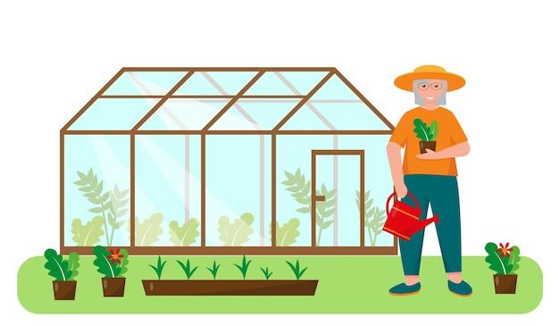 정원 가드닝 컨셉 디자인의 온실 근처에 식물과 물을 주는 노인 여성