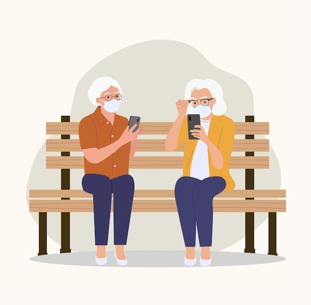 마스크를 쓴 노인 여성이 스마트 폰을 들고 벤치에 앉아있다. 플랫 만화 스타일 일러스트