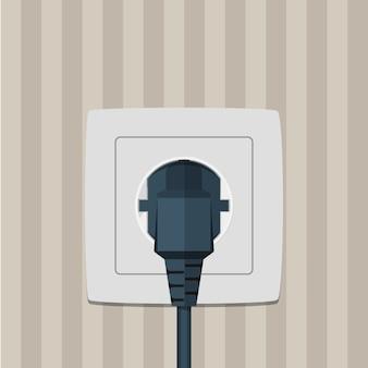 Электрическая вилка и розетка на стене.