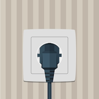 Electric plug and socket on a wall.