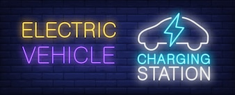 Electric vehicle charging station neon sign. Lightning and car silhouette on brick wall