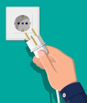 Электрическая розетка и рука с вилкой. электрические компоненты. настенная розетка с кабелем. векторная иллюстрация в плоском стиле