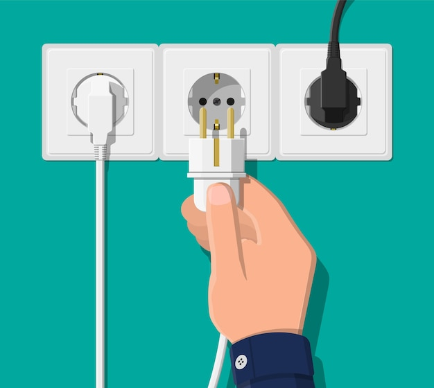 Электрическая розетка и рука с вилкой