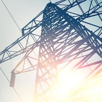 明るい空の上の高電圧の送電線。
