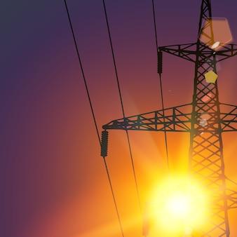 日没の送電線。