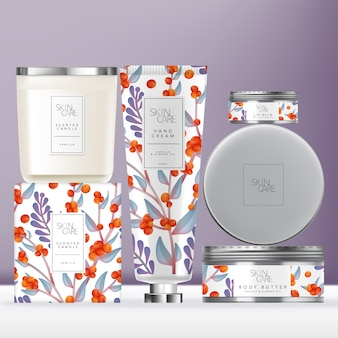 Elegance flower pattern toiletries or skin care set with hand cream tube, scented candle with metallic lid  & metallic lip balm or body butter tin jar. carton box outer packaging.
