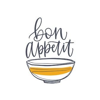 Elegant banner or poster with bowl and bon appetit phrase or wish handwritten with cursive calligraphic font