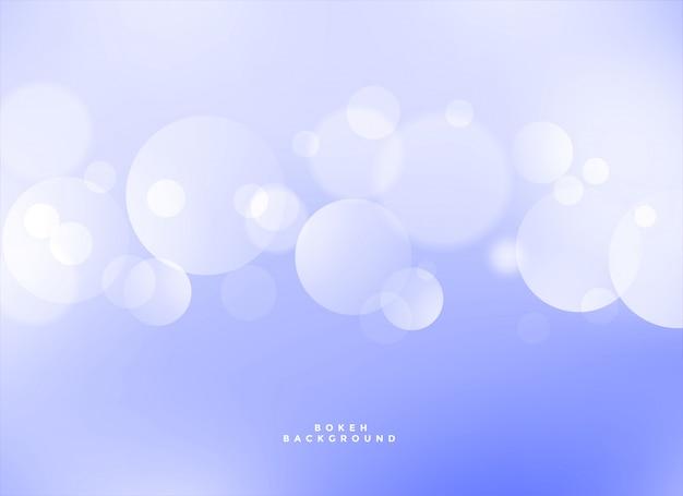 エレガントな青いボケの光の効果の背景