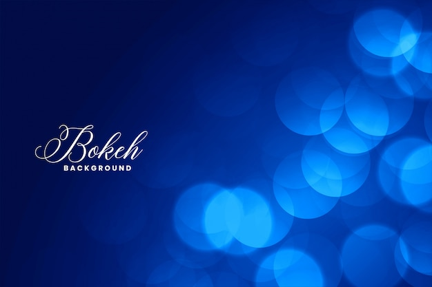 Elegant blue bokeh lights background with text space