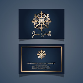 Elegant business card design with gold mandala