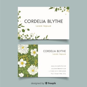 Elegant business card template with flowers and leaves