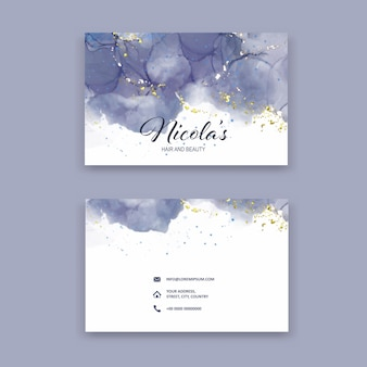 Elegant business card with a hand painted design with glittery gold elements