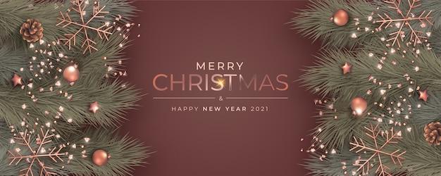 Elegante banner natalizio con ornamenti realistici