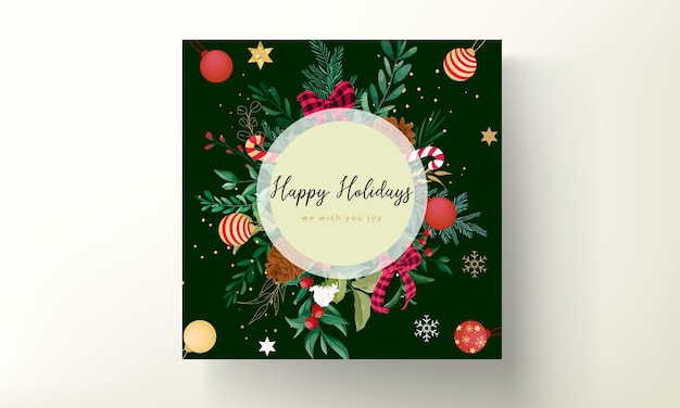 クリスマスの飾りと美しい葉を持つエレガントなクリスマスカードのデザイン