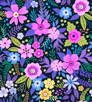 小さなカラフルな花のエレガントな花柄。リバティスタイル。ファッションプリントのための花のシームレスな背景。ちっぽけなプリント。シームレスなテクスチャ。春の花束。