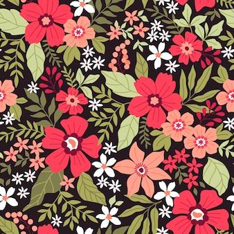 小さな色とりどりの花でエレガントな花柄。リバティスタイル。ファッションプリントのための花のシームレスな背景。頭が変なプリント。シームレスなベクターテクスチャ。春の花束。