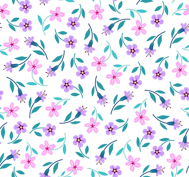 小さなライラックとピンクの花でエレガントな花柄。リバティスタイル。ファッションプリントのシームレス花柄。