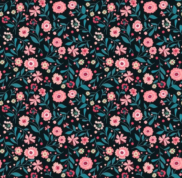 小さなピンクの花のエレガントな花柄。リバティスタイル。ファッションプリントのための花のシームレスな背景。ちっぽけなプリント。シームレスなテクスチャ。春の花束。
