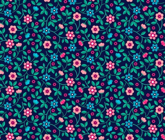 小さなピンクの花でエレガントな花柄。リバティスタイル。ファッションプリントのシームレス花柄。