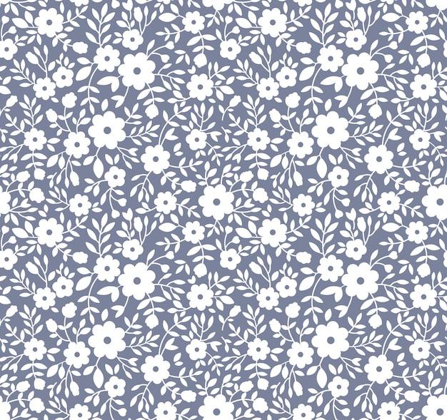 Элегантный цветочный узор в мелких белых цветках. бесшовный фон для модной печати.