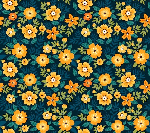 小さな黄色の花でエレガントな花柄。リバティスタイル。ファッションプリントのシームレス花柄。