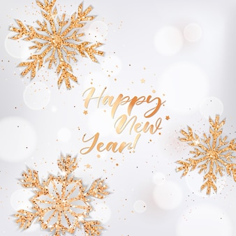 Элегантная поздравительная открытка с новым годом с золотыми хлопьями снега и блеском на белом размытом фоне и надписи. рождественские или новогодние поздравления, праздничная открытка, пригласительный флаер или дизайн брошюры
