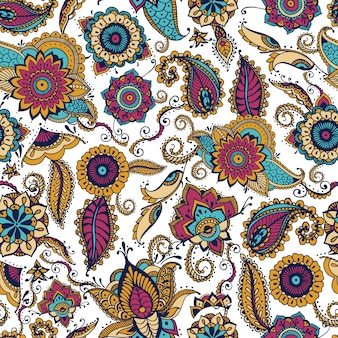 Элегантный бесшовный пейсли-узор с красочными индийскими мотивами бута и цветочными элементами менди