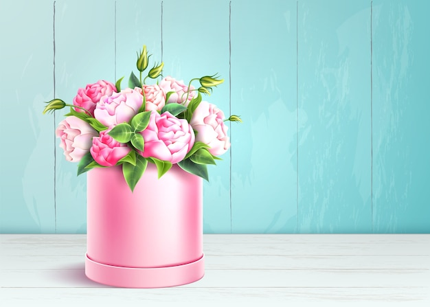 Элегантная розовая коробка на фоне деревянной стены.