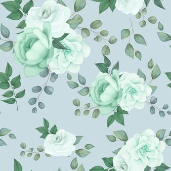 エレガントなシームレスパターンの緑の花と葉