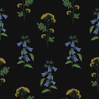 Elegant seamless pattern with embroidered blooming bellflower and tansy flowers on black background