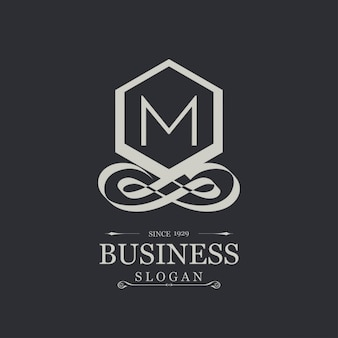 Elegant silver logo with the letter m