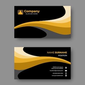 우아한 물결 모양의 금색과 검은색 명함 디자인 템플릿