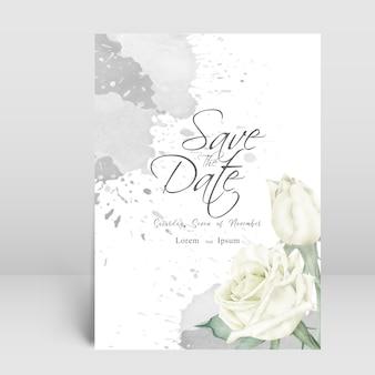 花と水彩のスプラッシュとエレガントな結婚式の招待カード