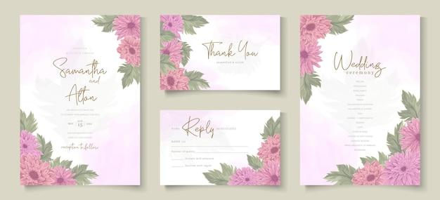 ピンクの菊の花飾りとエレガントな結婚式の招待状のデザイン
