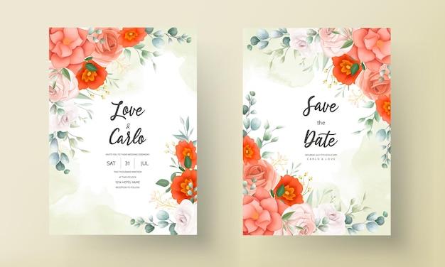 オレンジ色の花の装飾品とエレガントな結婚式の招待状