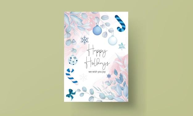 葉とクリスマスの飾りとエレガントな白いクリスマスカードのデザイン